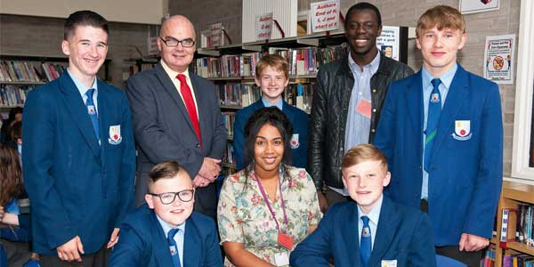 Councillor Andy Bowden (back row, second on the left) with St Augustine of Canterbury RC High School students - and Natalie and Nelson from the Anthony Walker Foundation