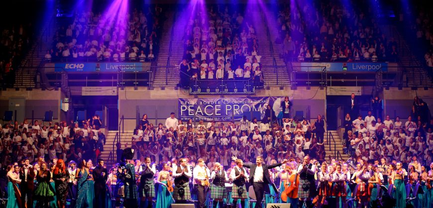 The orchestra and Peace Choir are given a standing ovation