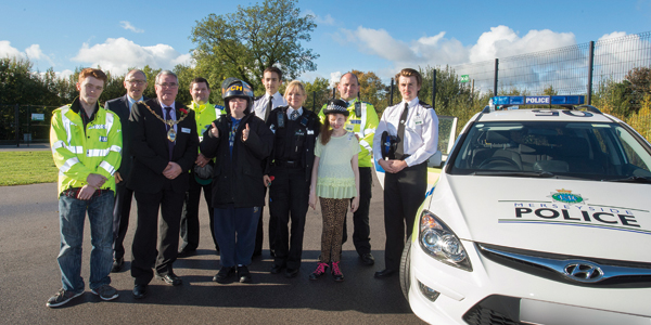 Mill Green pupils with councillor Dave Banks (front row: second left), headteacher Warren Brooks and members of Merseyside Police.