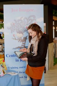 A reader at the Just Imagine stand