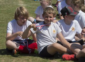 Pupils from Corpus Christi Primary School show off their medals