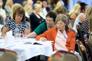 Delegates take notes during the keynote speeches