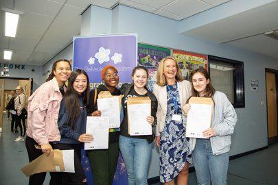 New Belvedere Principle Julie Taylor celebrates with students Emma Little, Charlotte Flynn, Lisa Dube, Emma Pollock and Amaka Eltingham-Onoura