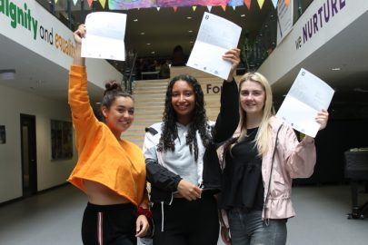 L to R: Happy trio Molly Dinage, Lucy Westwater and Desiree Coker hold their results aloft