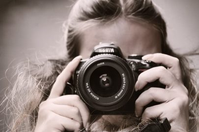 girl-holding-black-nikon-dslr-camera