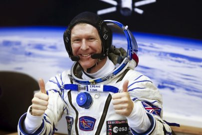 Crew member Timothy Peake of Britain gestures after donning a space suit at the Baikonur cosmodrome, Kazakhstan, December 15, 2015, before travelling on board the Soyuz TMA-19M spacecraft to the International Space Station (ISS).  REUTERS/Shamil Zhumatov - RTX1YQLH