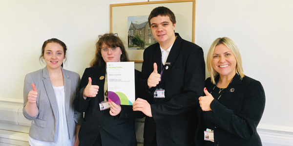 Left to right: Micah Grimshaw, head girl Megan, head boy Joe with headteacher Mrs Ania Hildrey with their School Award
