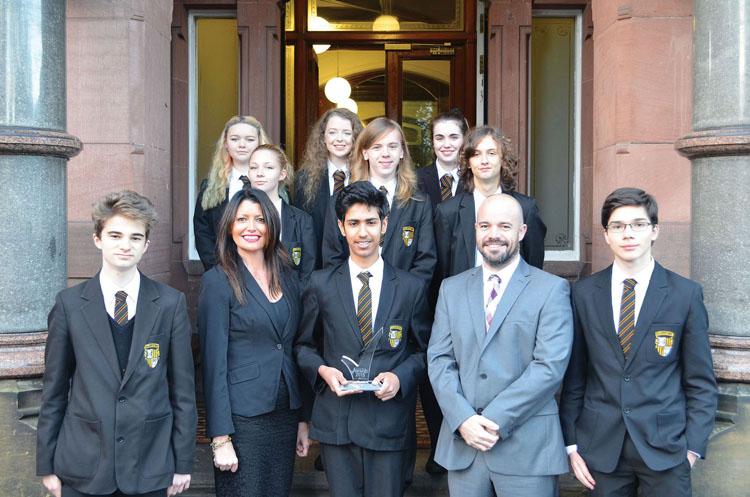 (L-R) Sharon Ellis, deputy headteacher with assistant headteacher Allan Preston and students