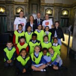 The children pose with the Liver Buildings staff in the stunning entrance hall