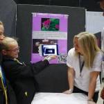 These Holly Lodge pupils proudly show off their work to staff from Unilever