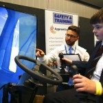 A boy tries out a digger simulator