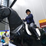 All smiles on the horse riding simulator