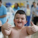 Thumbs up from this happy swimmer