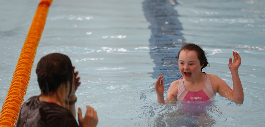 A delighted swimmer in full flow