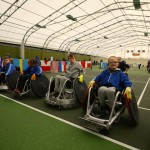Lining up before a Wheelchair Rugby drill