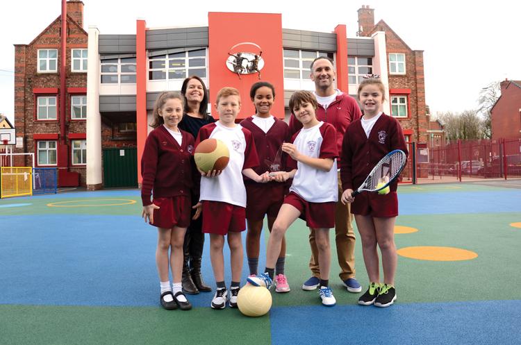 (L-R) Headteacher Phillippa Agate with PE co-ordinator Stephen McCann and pupils
