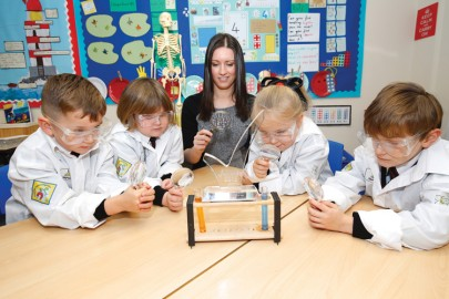 Science subject teacher Sarah Petrie with young scientists