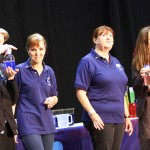 Two volunteers help out on stage
