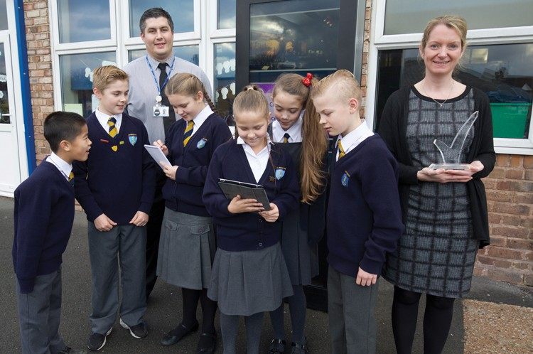 Paul Vine, deputy head and Nicola Truman, headteacher with pupils